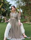 photo of Fancy Party Wear Dark Beige Color Rayon Fabric Embroidered Kurti With Pant