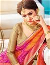 photo of Mesmerizing Georgette Rani Color Party Wear Bandhej Saree