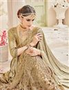 photo of Designer Reception Wear Beige Color Net Fabric Fancy Embellished Saree