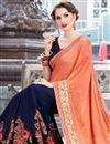 photo of Stone Work Embroidered Navy Blue And Peach Fancy Wedding Wear Saree In Art Silk And Georgette