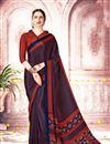 image of Fancy Crepe And Art Silk Daily Wear Rust Saree