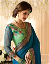 photo of Blue And Green Color Silk And Georgette Fabric Reception Wear Designer Saree With Thread Zari And Embroidery Work And Beautiful Blouse Designs