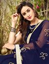 photo of Navy Blue Georgette Printed Casual Wear Saree With Lace Border