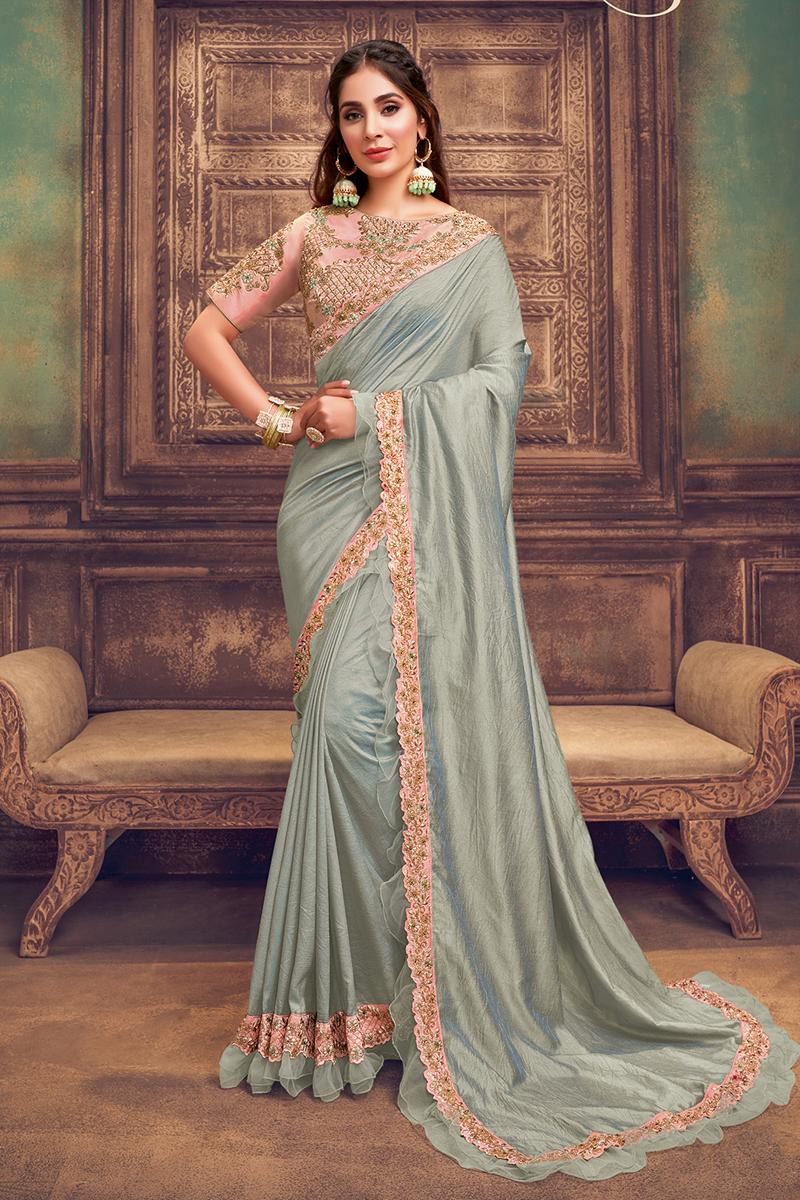 Function Wear Grey Color Ruffle Border Saree In Georgette Silk Fabric