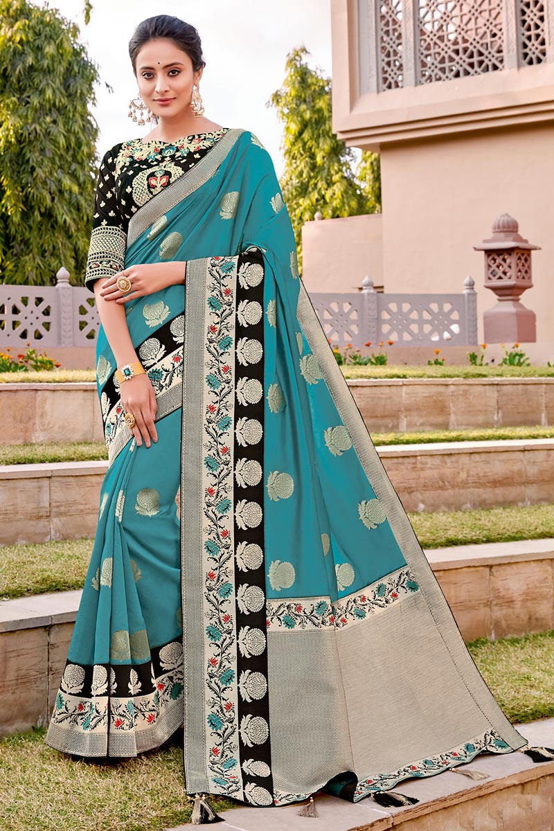 Silk Fabric Traditional Wear Trendy Cyan Color Weaving Work Saree