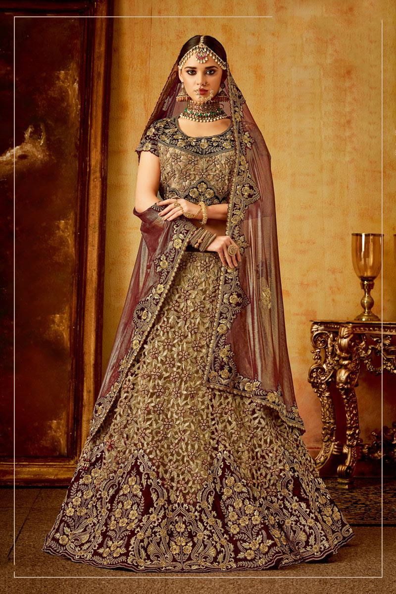 Occasion Wear Velvet Embroidered Lehenga In Golden With Designer Blouse