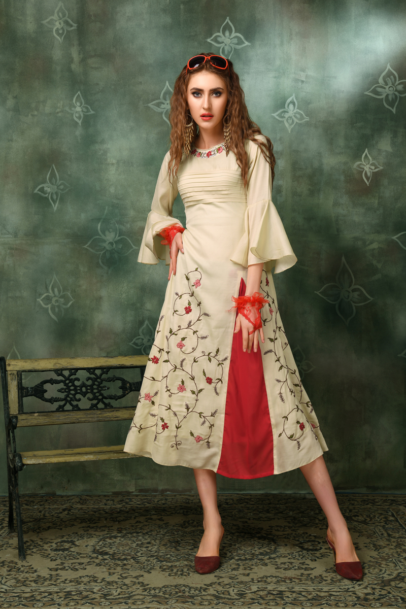 Exclusive Cream Color Heavy Designer Fancy Fabric Kurti