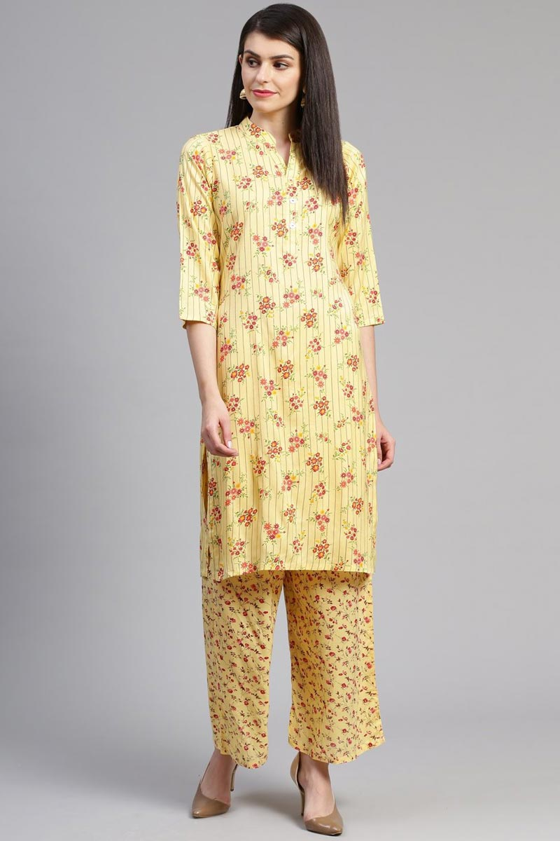 Exclusive Casual Wear Yellow Color Rayon Fabric Kurti With Bottom