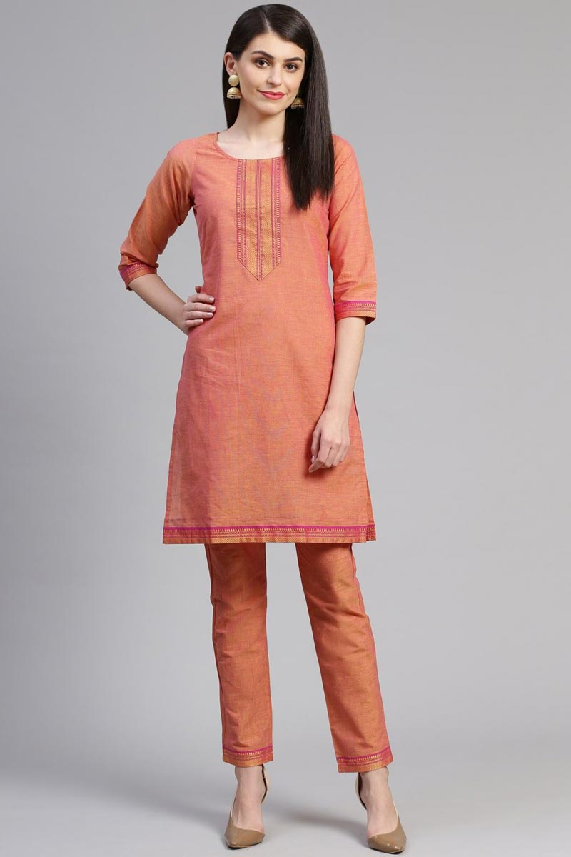 Exclusive Casual Wear Fancy Cotton Fabric Peach Color Kurti With Bottom