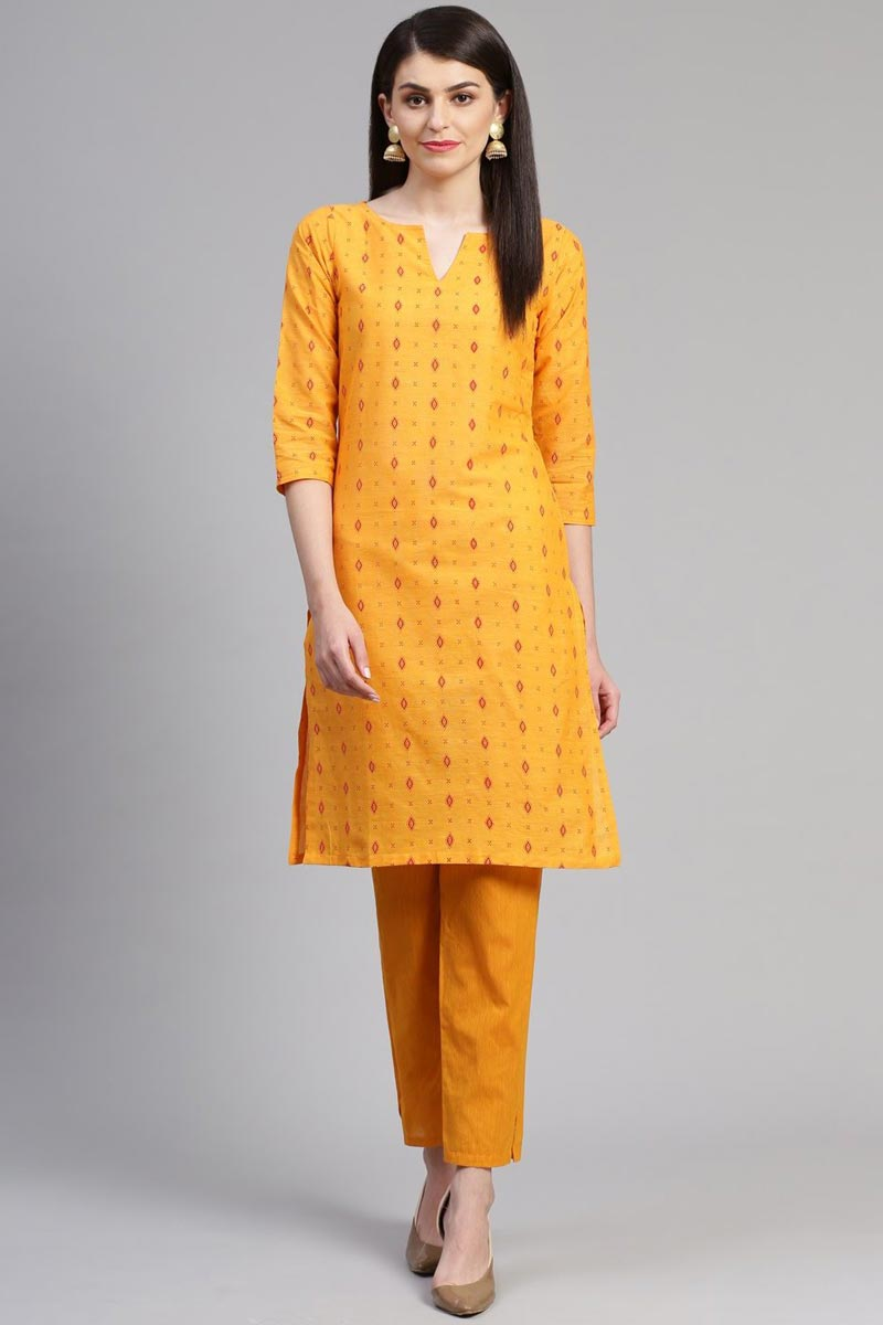 Exclusive Casual Wear Fancy Yellow Color Cotton Fabric Kurti With Bottom
