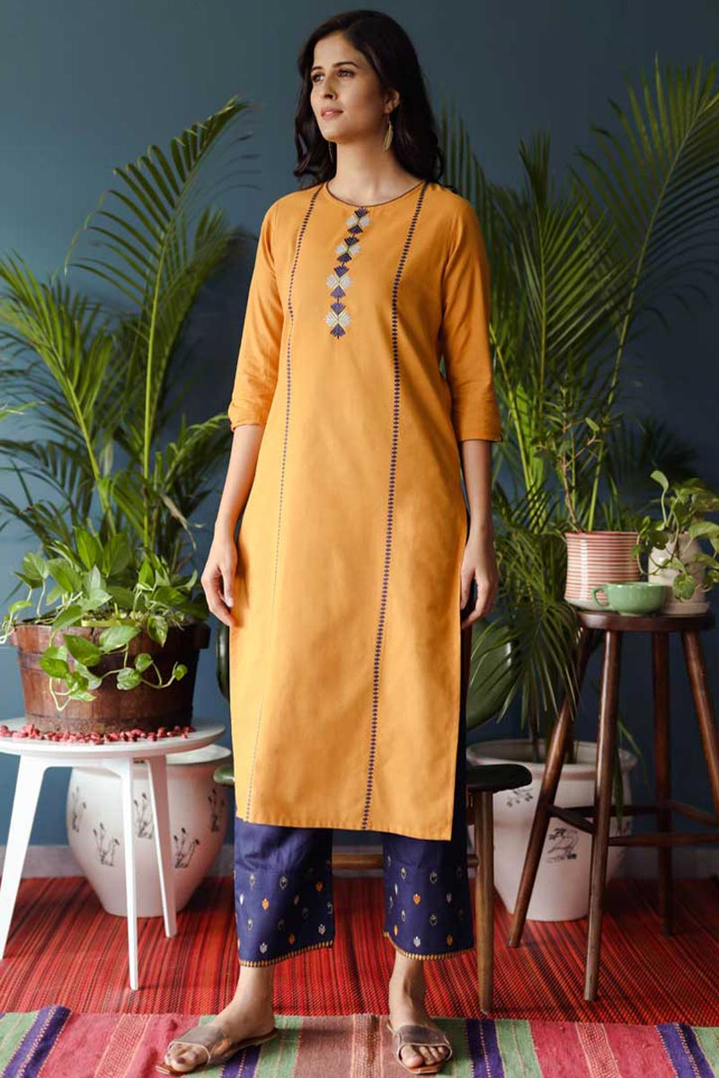 Exclusive Orange Color Casual Wear Cotton Fabric Kurti With Bottom