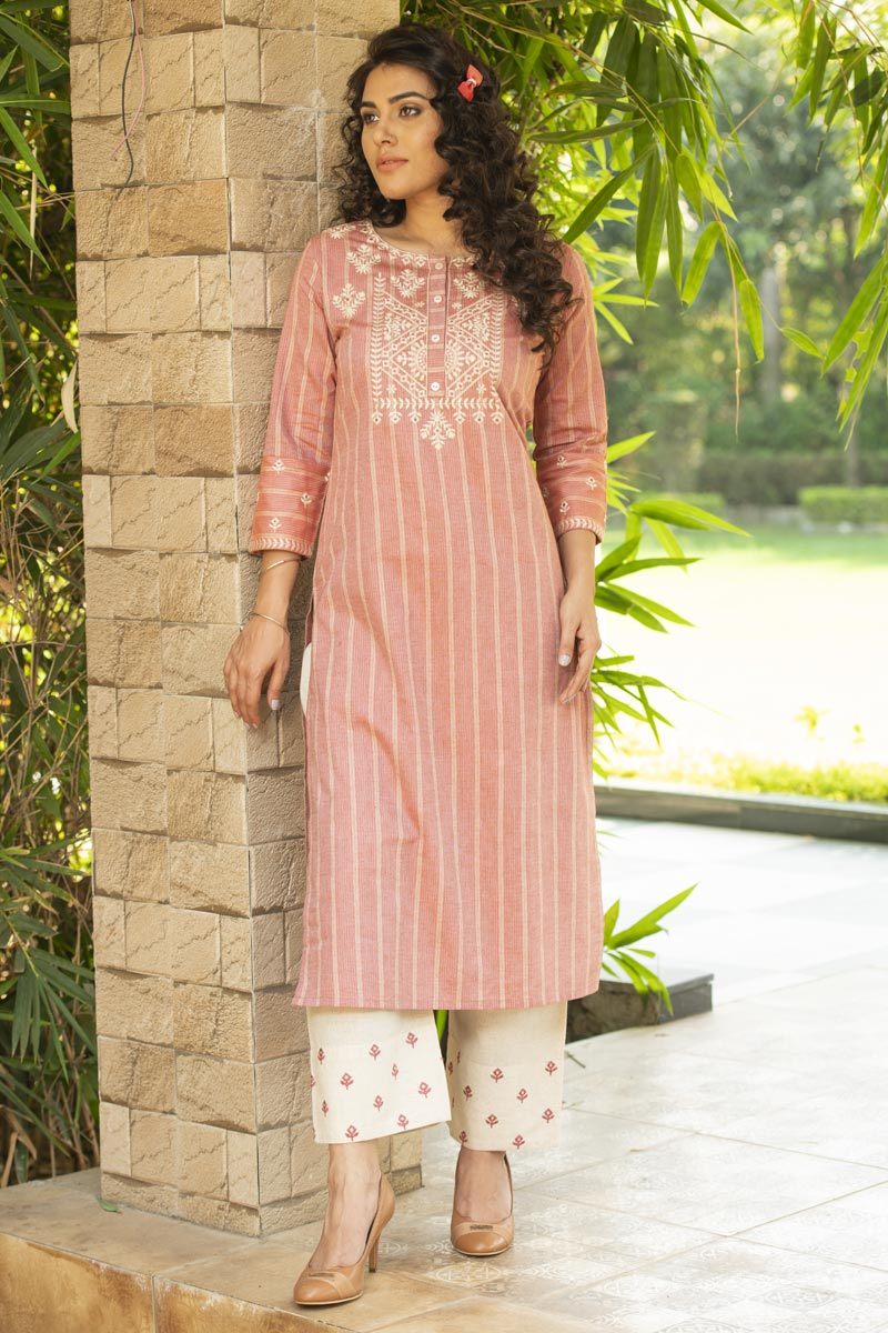 Exclusive Casual Wear Peach Color Cotton Fabric Kurti With Bottom