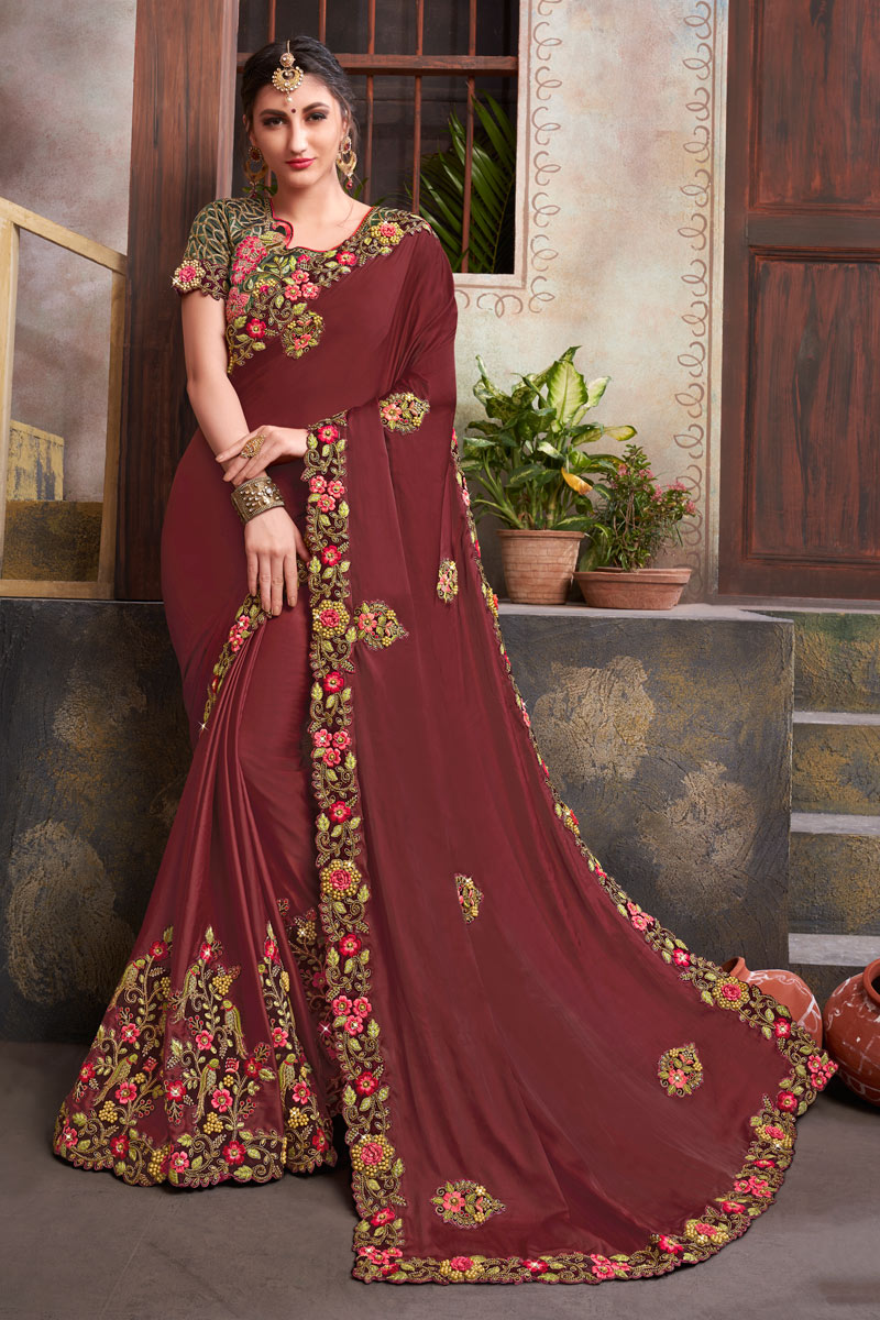 Classic Embroidery Work Designs On Fancy Fabric Occasion Wear Saree In Maroon Color