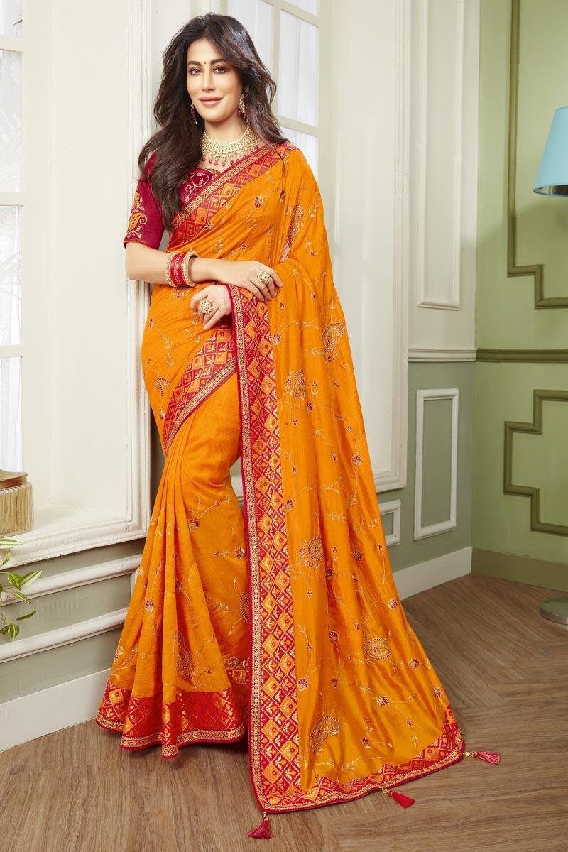 Chitrangada Singh Fancy Fabric Function Wear Orange Color Embroidered Saree