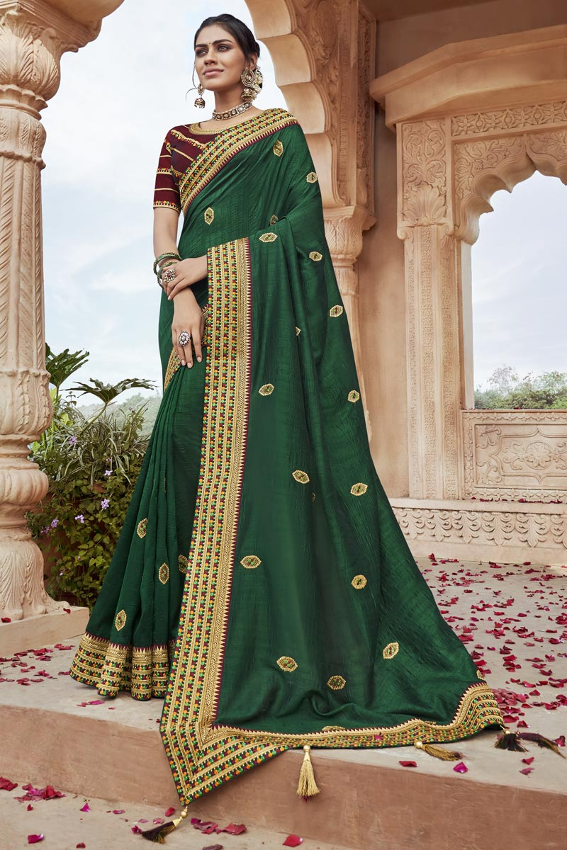 Party Wear Fancy Fabric Chic Embroidered Saree In Dark Green Color