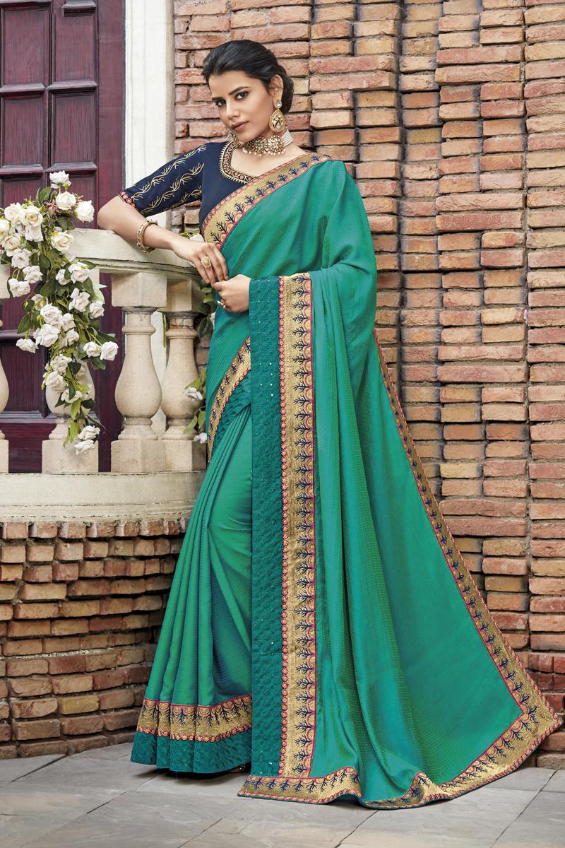 Festive Special Light Teal Color Fancy Fabric Festive Wear Saree