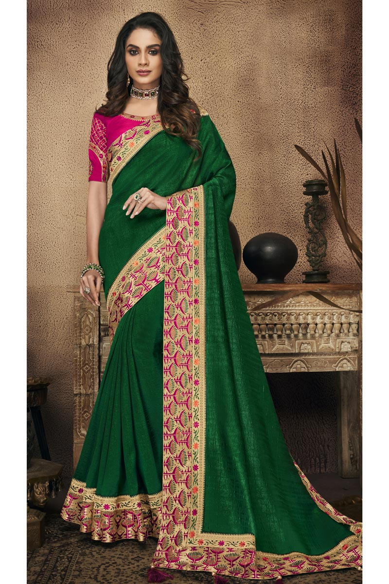 Border Work On Green Fancy Fabric Party Wear Saree With Amazing Blouse