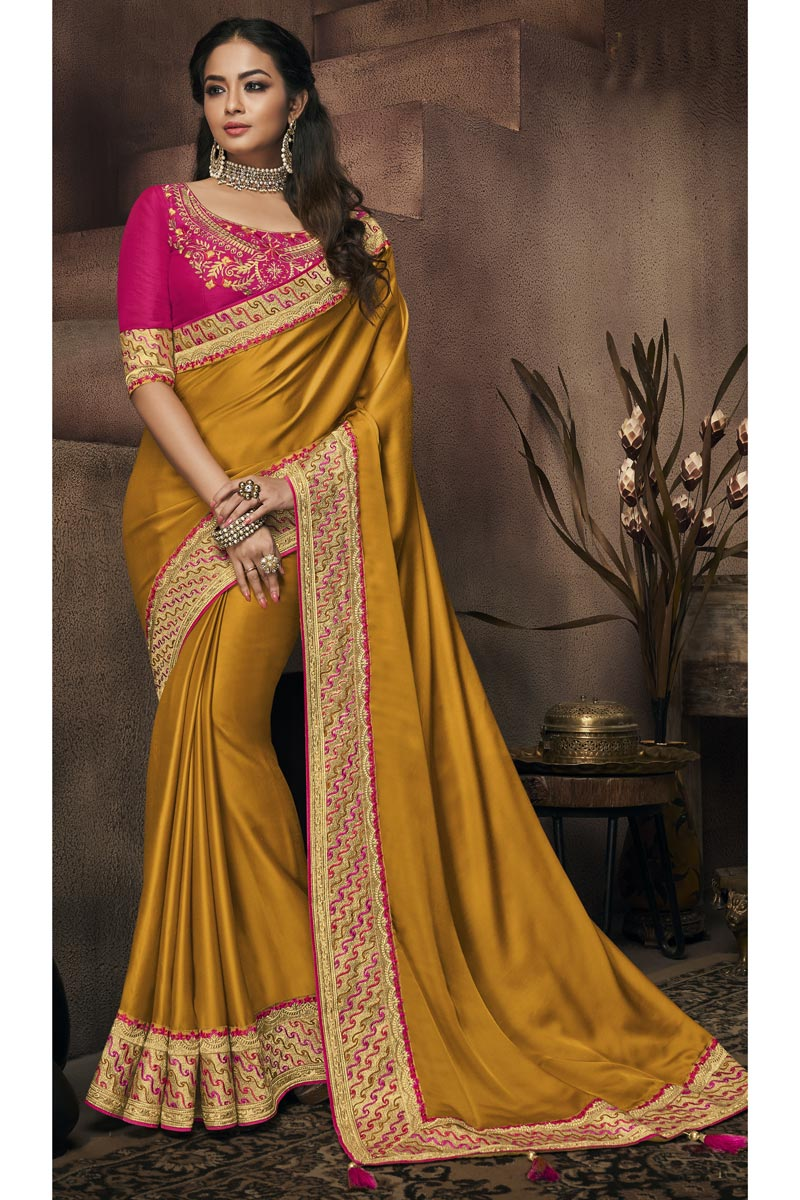 Mustard Party Wear Saree In Fancy Fabric With Border Work And Beautiful Blouse