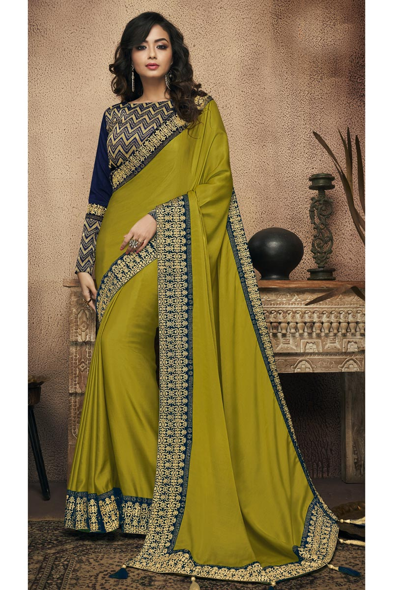 Green Fancy Fabric Wedding Wear Saree With Border Work And Gorgeous Blouse