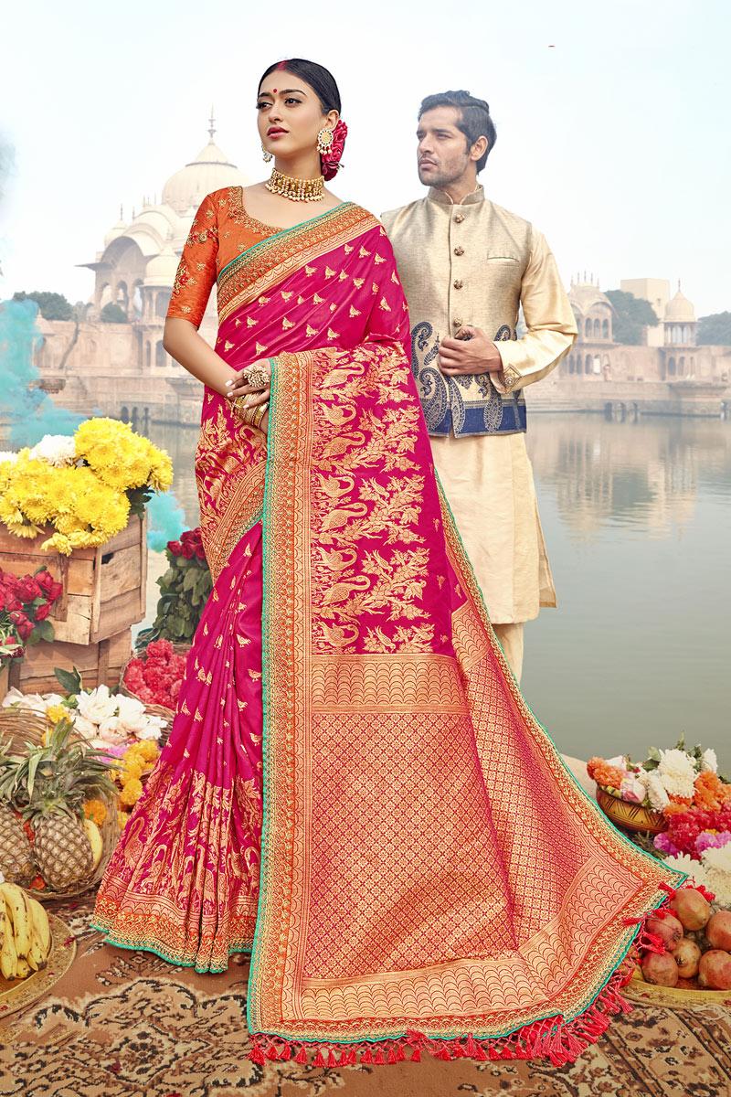 Weaving Work On Rani Color Party Wear Saree In Banarasi Silk Fabric With Beautiful Blouse