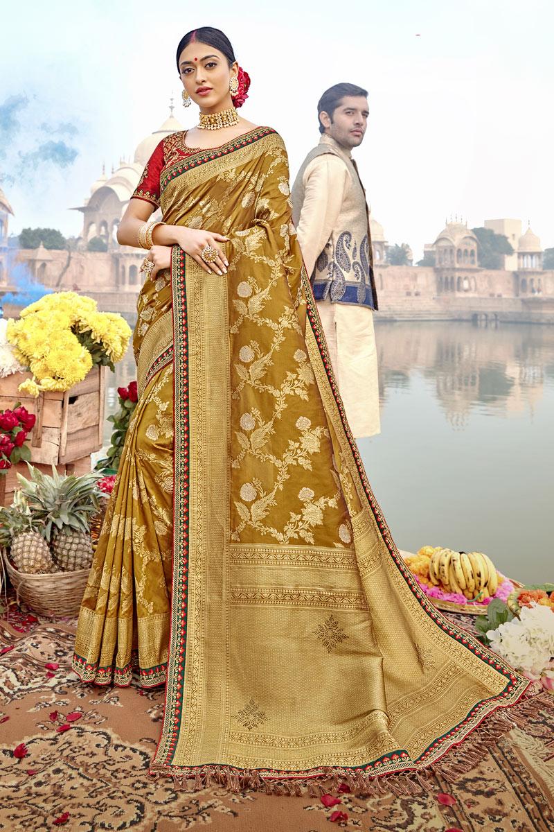 Golden Color Banarasi Silk Fabric Occasion Wear Saree With Weaving Work And Designer Blouse