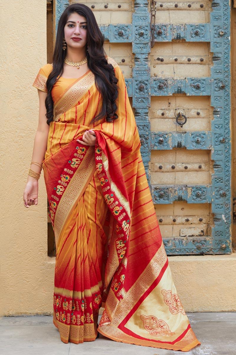 Puja Wear Orange Trendy Weaving Work Saree In Art Silk Fabric