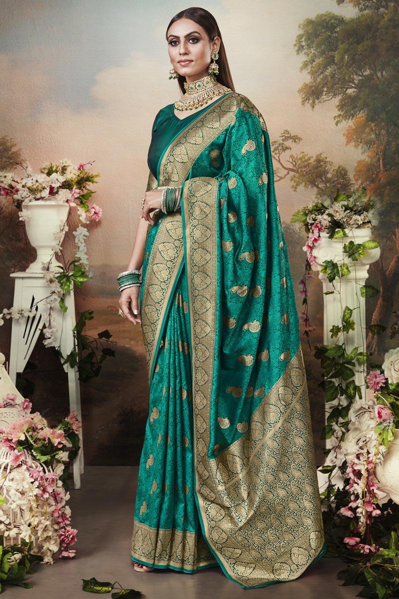 Puja Wear Art Silk Fabric Classic Weaving Work Saree In Teal Color