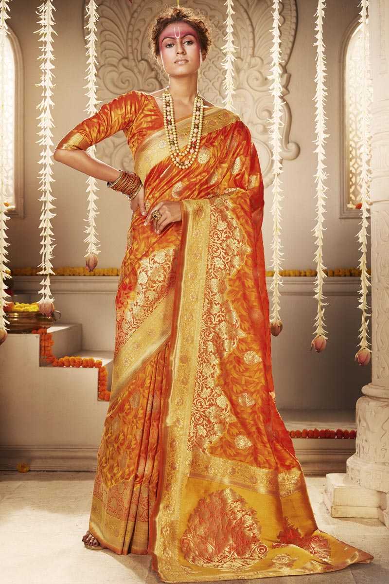 Art Silk Trendy Puja Wear Orange Color Weaving Work Saree