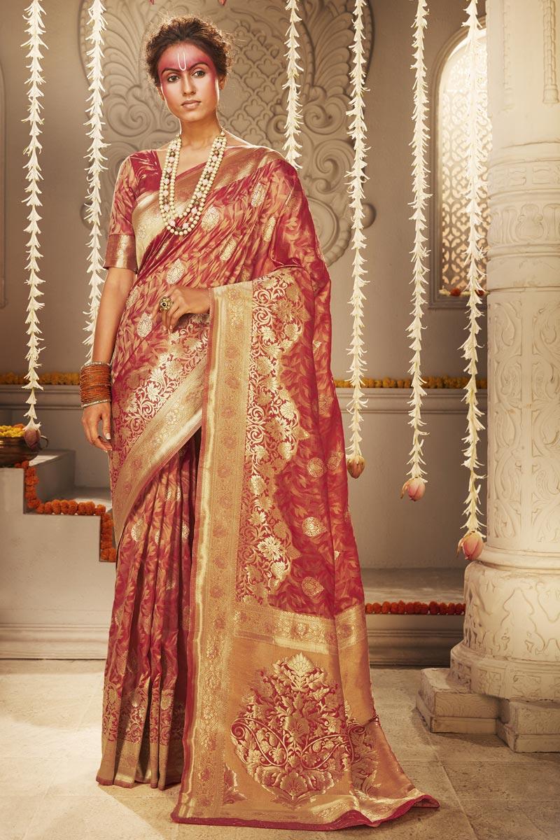 Puja Wear Trendy Rust Color Weaving Work Saree In Art Silk