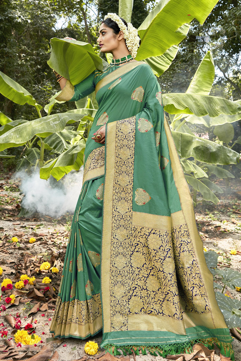 Fancy Banarasi Silk Fabric Sea Green Color Saree With Weaving Work