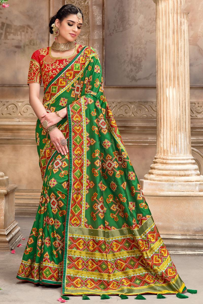 Festive Wear Patola Silk Fabric Saree In Green Color