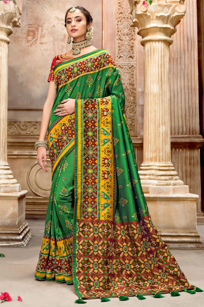 Dark Green Color Patola Silk Fabric Festive Wear Saree