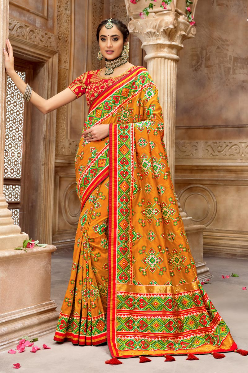 Function Wear Orange Color Saree In Patola Silk Fabric