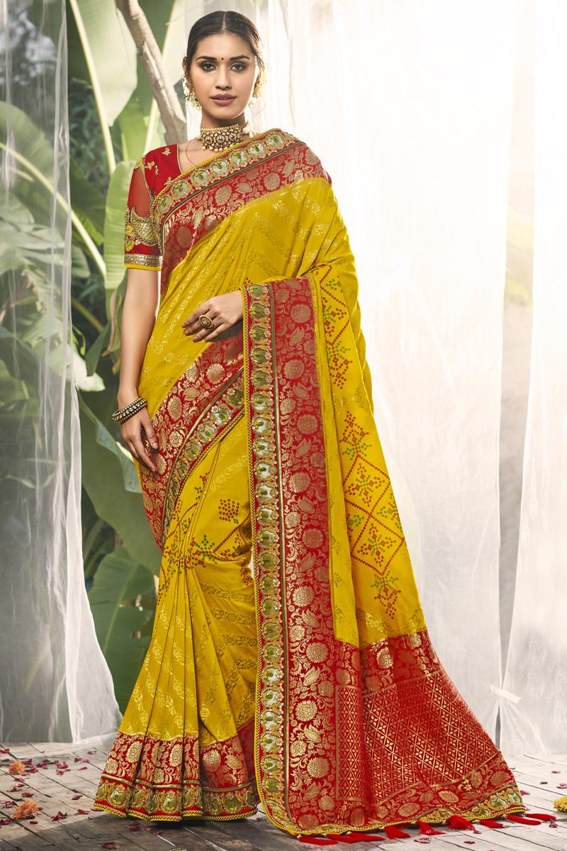 Wedding Wear Fancy Yellow Color Silk Fabric Saree With Embroidered Blouse