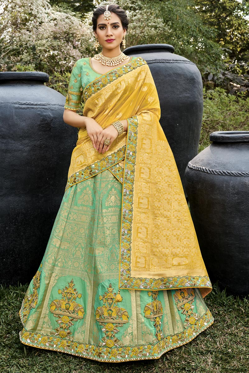 Sea Green Color Function Wear Silk Fabric Weaving Work Lehenga Choli