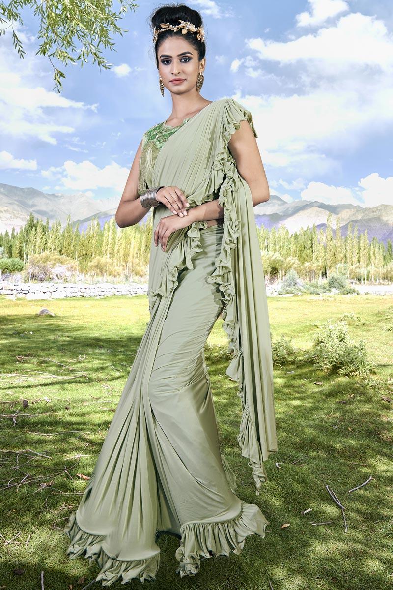 Trendy Sea Green Sangeet Function Wear Fancy Fabric Ruffle Frill Saree