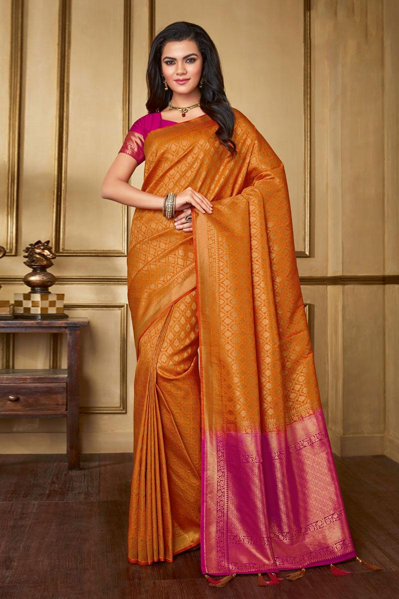 Art Silk Fabric Orange Color Festive Wear Saree With Weaving Work