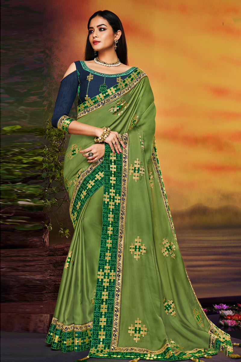 Fancy Fabric Designer Saree With Embroidery Work On Green Color