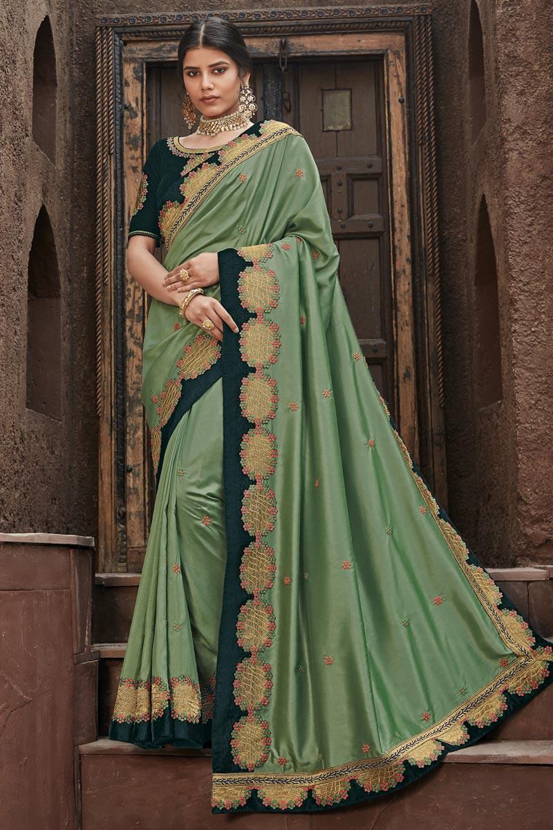 Sangeet Wear Fancy Fabric Border Work Saree In Sea Green Color