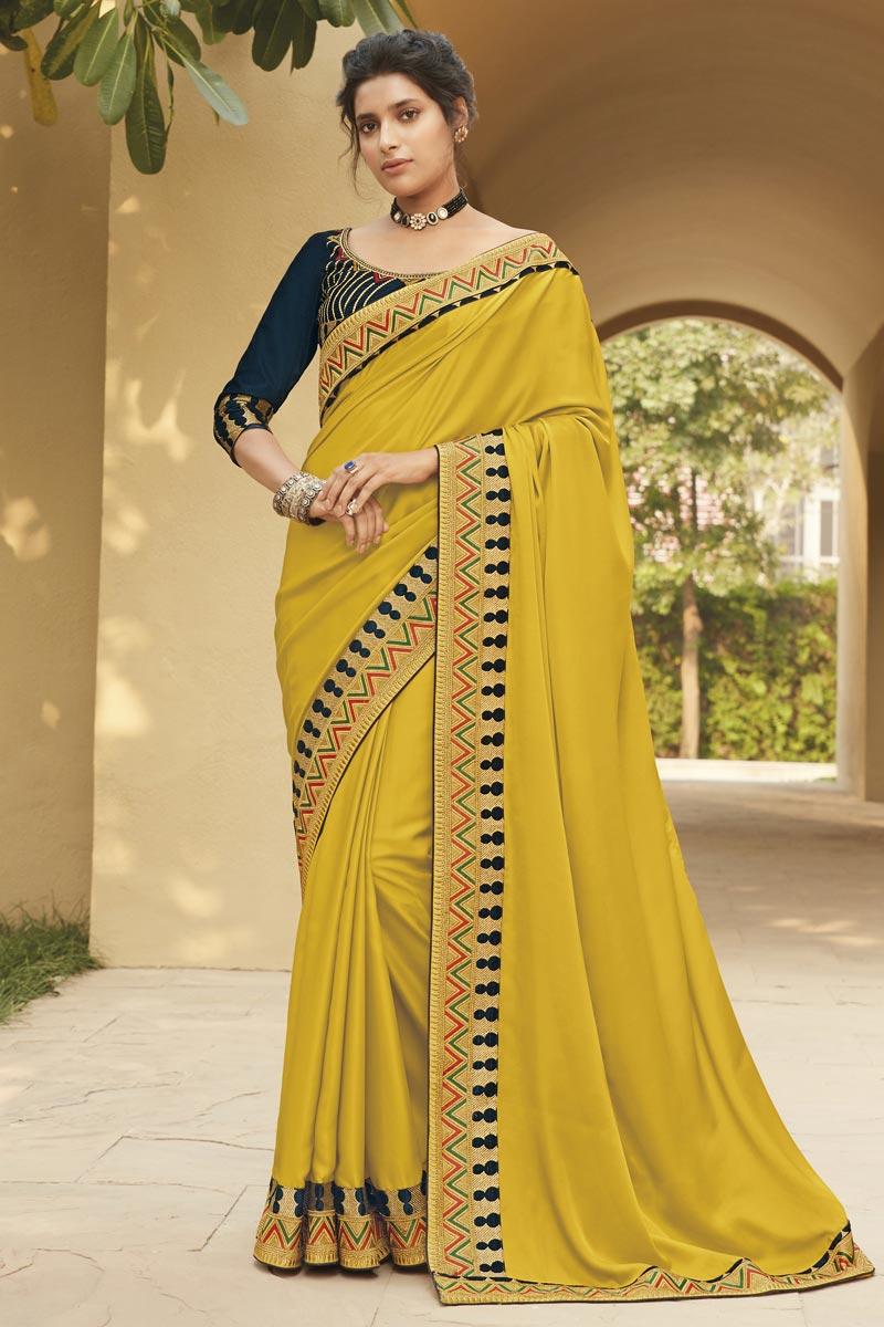 Mustard Color Fancy Fabric Festive Wear Embroidery Work Saree