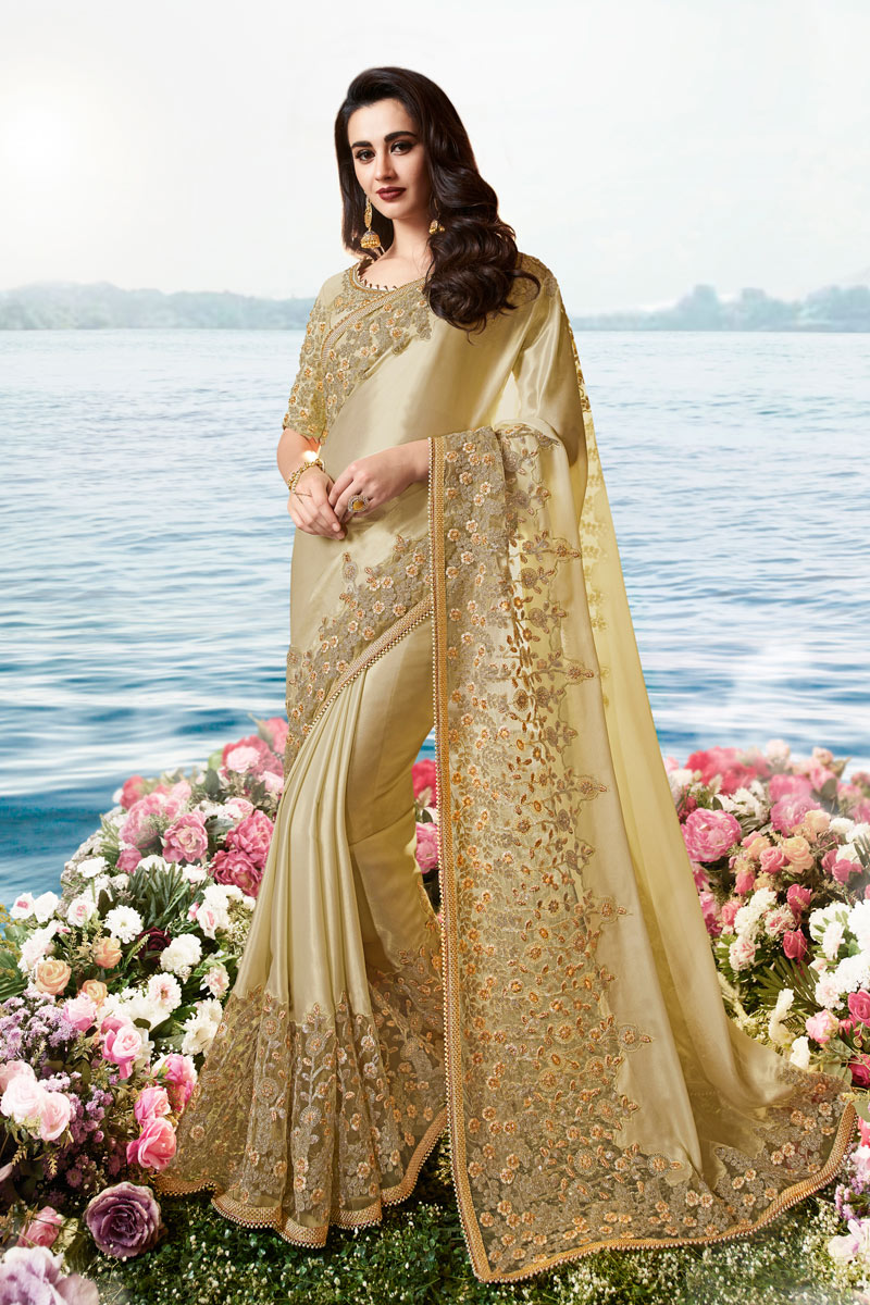 Eid Special Cream Color Viscose And Net Fabric Occasion Wear Saree Embroidery Work And Designer Blouse