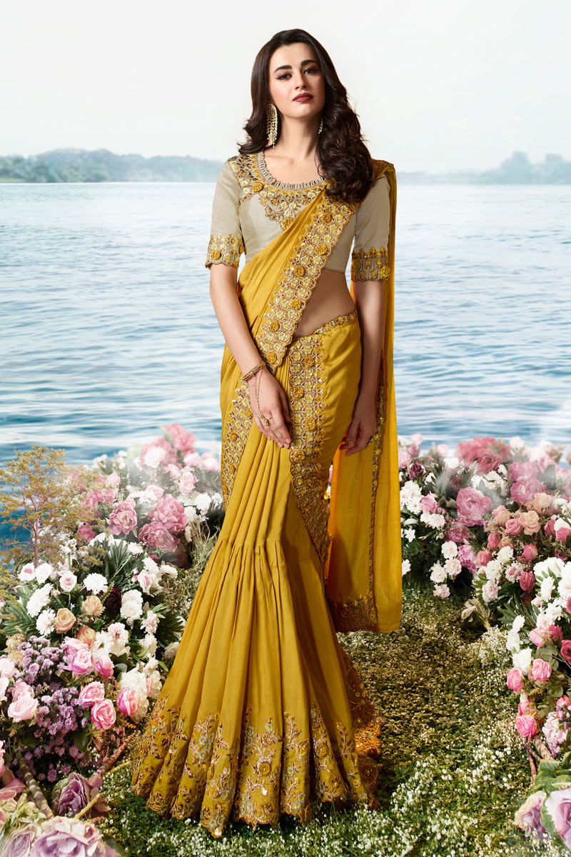 Mustard Color Art Silk And Net Fabric Occasion Wear Saree With Embroidery Work And Elegant Blouse