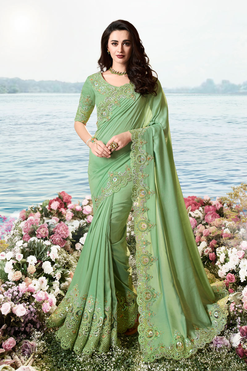 Viscose And Net Fabric Sea Green Color Party Wear Saree With Embroidery Work And Beautiful Blouse