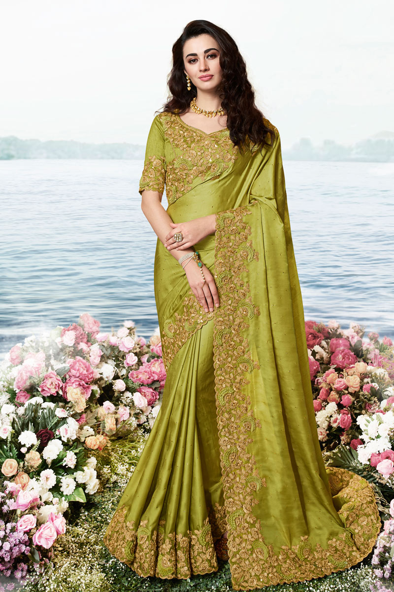 Eid Special Embroidery Work On Olive Color Art Silk And Net Fabric Function Wear Saree With Enigmatic Blouse