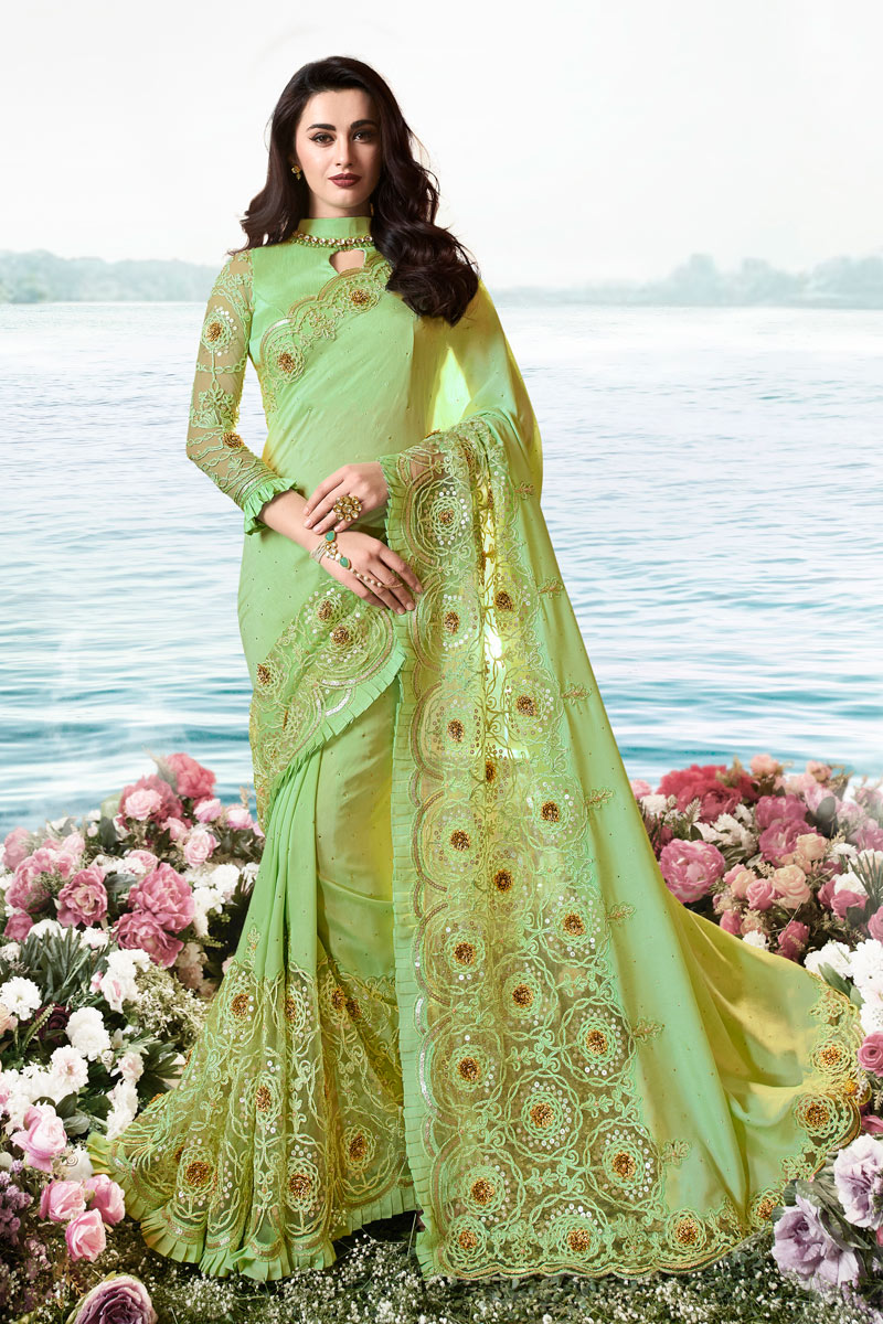 Art Silk And Net Fabric Festive Wear Saree In Sea Green Color With Embroidery Work And Fantastic Blouse