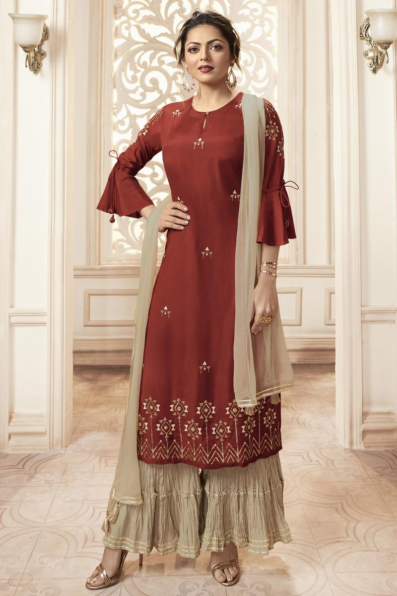 Drashti Dhami Party Wear Rust Color Embroidered Readymade Sharara Suit In Viscose Fabric