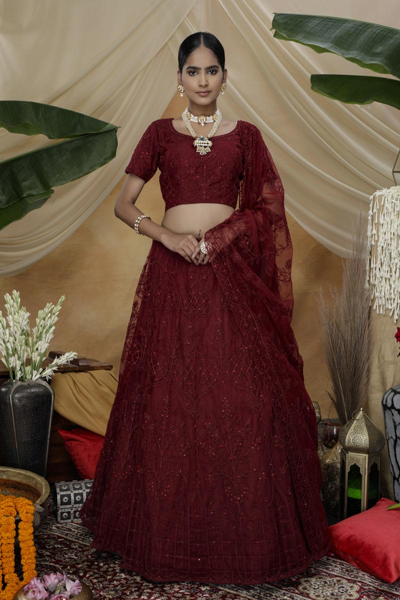 Function Wear Net Fabric Thread Embroidered Maroon Color Lehenga Choli