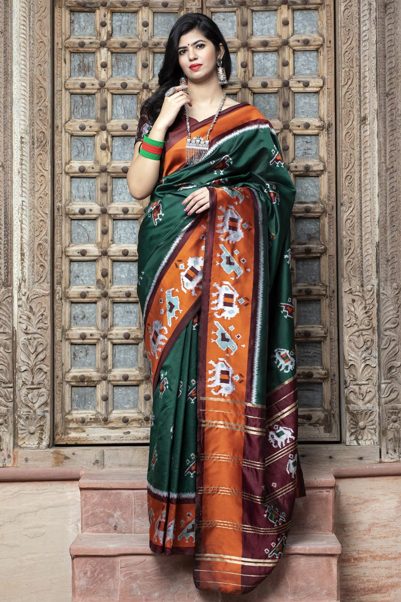 Art Silk Chic Festive Wear Dark Green Color Patola Weaving Work Saree