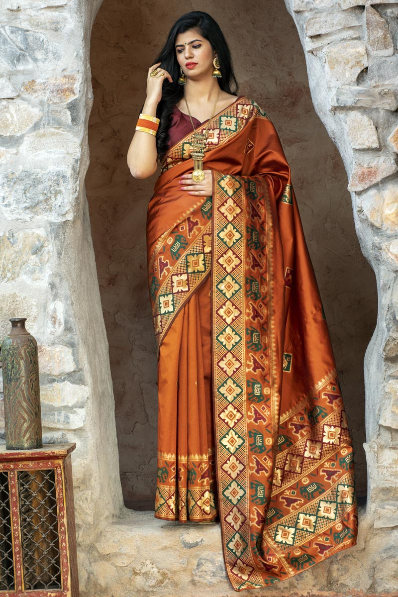 Art Silk Party Wear Fancy Patola Weaving Work Saree In Orange Color