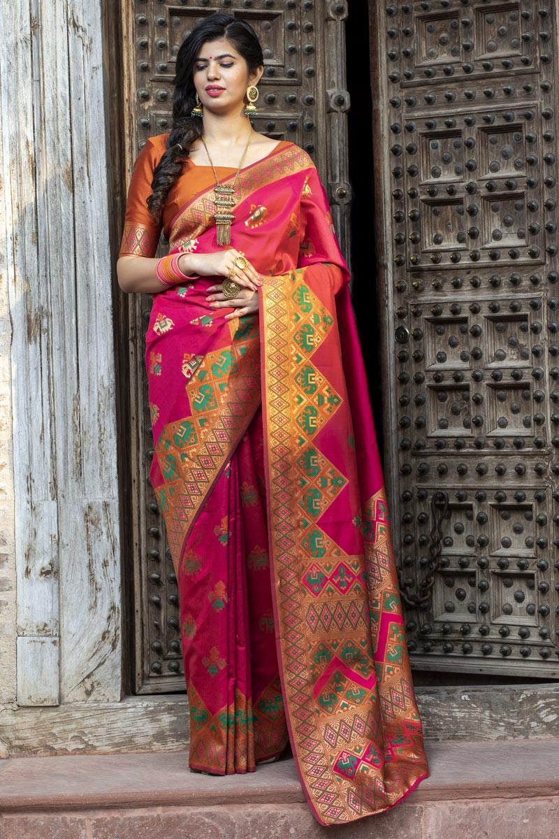 Party Wear Art Silk Fancy Patola Weaving Work Saree In Rani Color